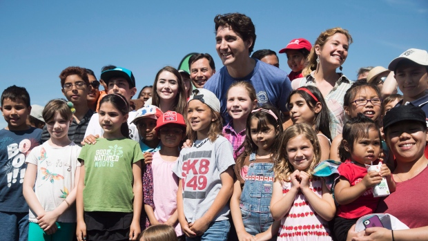 Photo of The Prime Minister of Canada Justin Trudeau with children
